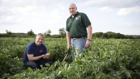 Kettle Foods' MD Ashley Hicks with grower James Harrison. Mr Harrison has been filming with Made in