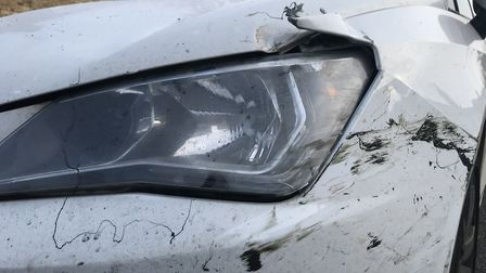 One of the cars on Borrowdale drive which was damaged in the hit and run last night. Picture: Ella W