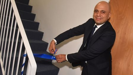 Sajid Javid met business owners and staff at the Norfolk Cleaning Group. He cut a ribbon to open a n