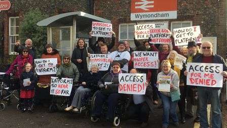 Protesters at Wymondham Train Station demanded action on step free access to platform two. Photo: Su