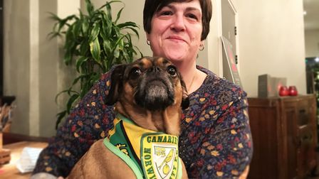 Sandra Clabburn with her Norwich City supporting pug at the Pug Cafe. Picture: Ella Wilkinson