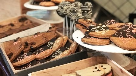 PUPcakes, Dognuts, PAW-ty Rings, WOOFins, PAWbons, and PAWsecco are on offer at the Pug Cafe at Revo