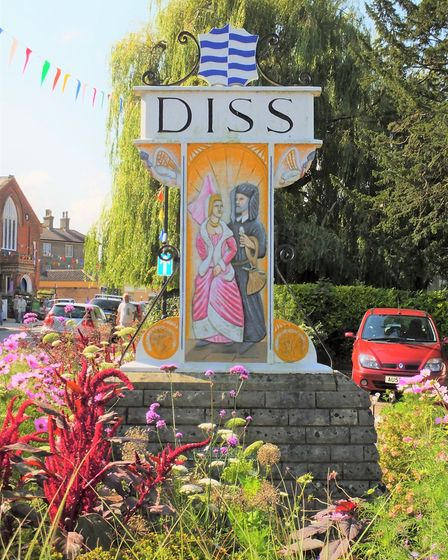 The Diss town sign. This side shows Matilda, having escaped King John, after joining her newly marri