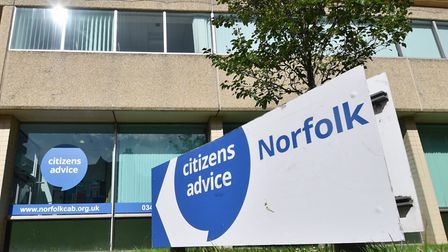 A single mother at real risk of homelessness had thousands in debt paid off by two Norfolk councils