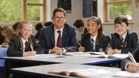 Students at Wymondham College with headteacher Dan Browning. The college's boarding provision retain