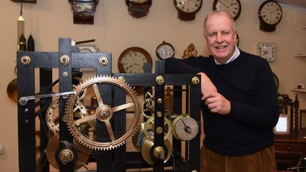 Antique clock and scientific instrument collector, Paul Nunn, with a Norwich-made turret clock by Be