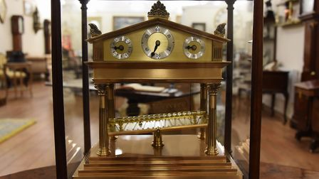 A congreve rolling ball clock, using a rolling ball rather than a pendulum to regulate time. Dated a
