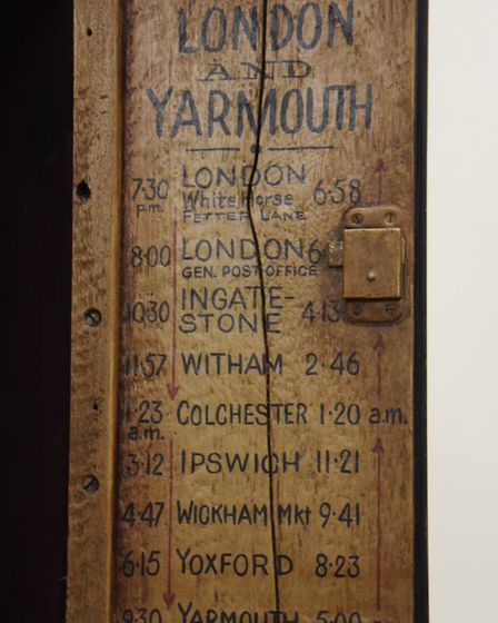 Inside the door of an 18th century style Tavern clock is the timetable of the stagecoach and where t
