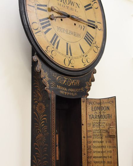 An 18th century style Tavern clock, with The Crown, Framlingham on the dial. Inside the door is the