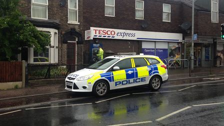 Police on scene at an armed robbery and carjacking at Bull Close Road, Silver Road and Magdalen Road