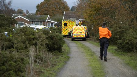 Emergency services at the scene after a body was found in River Waveney near Diss. Picture: Simon Pa