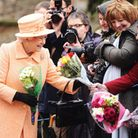 HM the Queen was presented with flowers by well wishers after morning service at Wolferton Church. P