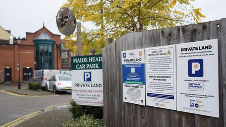 Signs at the Maids Head Hotel car park. Picture: DENISE BRADLEY