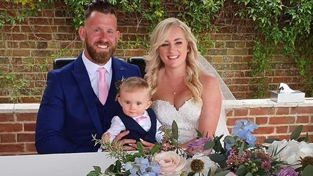 Lewis Taylor, wife Nikki and son Finley. Mr Taylor was charged £100 for three minutes parking. Pictu