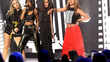 Jesy Nelson, Leigh-Anne Pinnock, Jade Thirlwall and Perrie Edwards of Little Mix perform on stage du