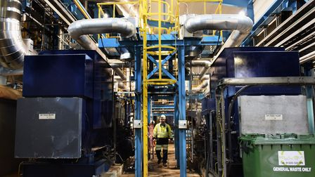 Adam Kennard, King's Lynn Power Station manager, in the boiler house by the main water feed for the