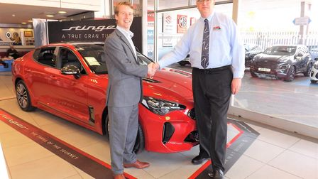Doing his day job: Holden Group CEO Tim Holden (left) and Grant Long, general manager of the former