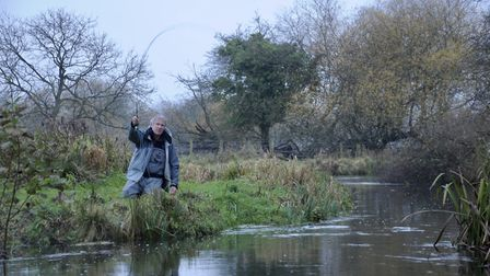 John Bailey playing a grayling on the river Test where a day's fishing can cost more than a week in