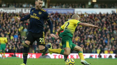 Teemu Pukki of Norwich is fouled by Calum Chambers of Arsenal during the Premier League match at Car