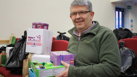 Major Alex Bishop, of Sheringham Salvation Army, with some of the toys the corps will be delivering