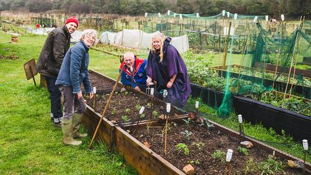 NSFT staff at Marlpit Community Garden where service users have been able to enjoy being outside, re