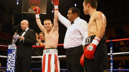 Michael Walsh's arms are raised in victory after his October 2010 first-round win over Ian Bailey at
