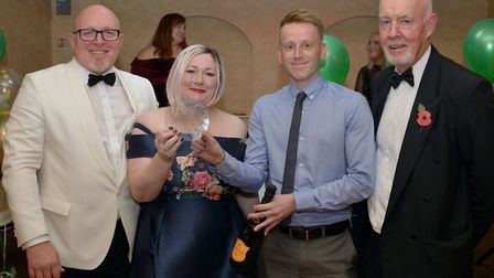 Kat McGill and Jordan Weavers from the Transformation Team receive the Chair's Award from ECCH Chair