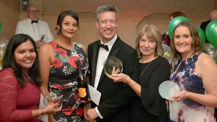 The MSK Physiotherapy Team receive the Innovation award from Executive Director of Finance Simon Bra