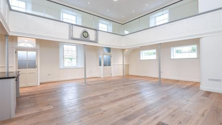 The main reception which doubles as a living area with a kitchen and three bedrooms off this. Pic: w