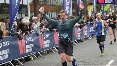 Mark Armstrong cuts a relieved figure as he crosses the Greater Manchester Marathon finish line. Pic