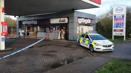 The Esso service station on the A10 south of King's Lynn has ben sealed off by police investigaing a