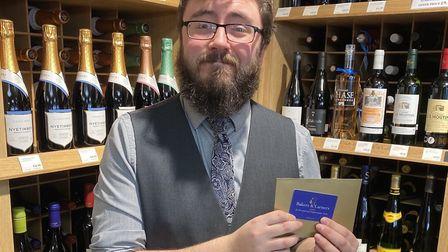 Patrick Sewell, holding one of the gold envelope's containing a £250 gift card to spend in store.Pic