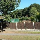 A plot of land on Yarmouth Road in Lowestoft that has planning permission for a detached chalet bung