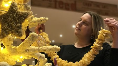 It took food artist Prudence Staite three weeks to create the crisp garlands, cheese cows and onion