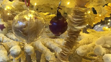 Red onion baubles and crisp garlands decorate the Kettle Foods cheese Christmas tree at The Feed, so