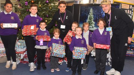 NCFC Visit Mile Cross school and hand out Christmas presents to the students. Pictures: BRITTANY WOO