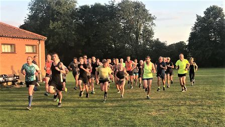 Action from a Bure Valley Harriers training session. Picture: Neil Featherby