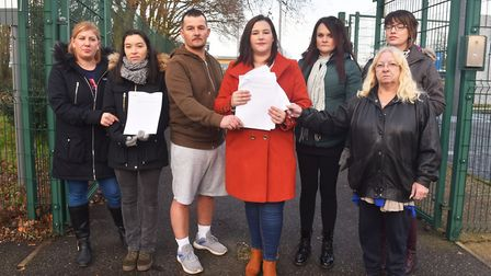 Sam Gravener and other parents at Heartsease Primary Academy handing in a petition against changes t