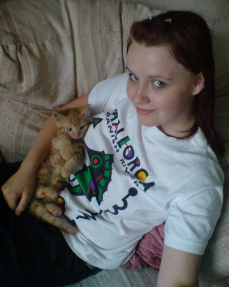 AJ O'Connor with her cat Scats, when he was a kitten. Picture: AJ O'Connor