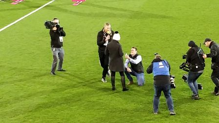 She said yes! man proposes to girlfriend at Carrow Road. Picture: Michael MacNeill