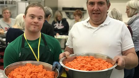 Tommy Maile, 33 from Sprowston with head chef John Williams with some of the 100kg of carrots that v