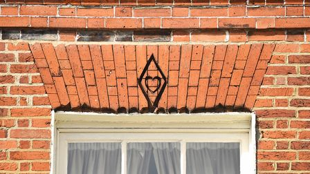 The Witch's heart carved into the building on the Tuesday Market Place in King's Lynn. Picture: Ian