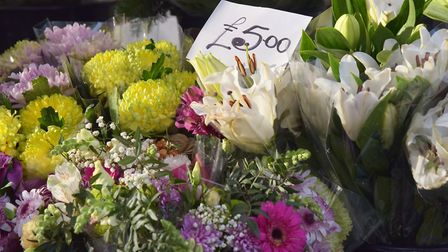 Alexander Pond, owner of Pond's Flowers, said the business has been open for 200 years. Byline: Sony