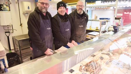 Steve Boardley, Samm Bemment and David Neech work at City Fish, which has lived in the market for 47