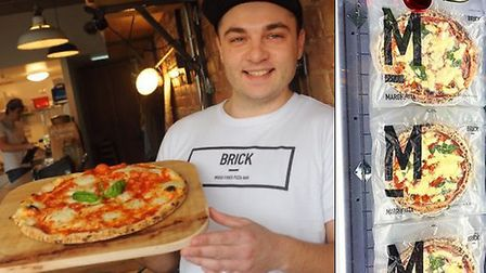 Brick Pizza based in Norwich has launched a frozen range - pictured is co-owner George Colley. Pict