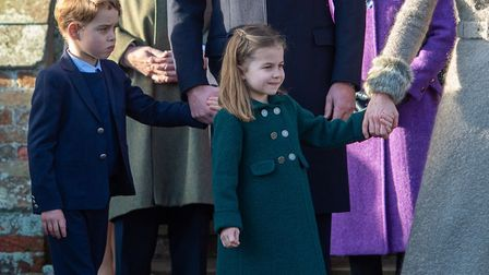 Prince George and Princess Charlotte after attending the Christmas Day morning church service at St