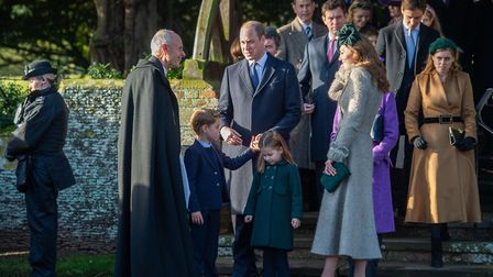 The Duke and Duchess of Cambridge with Prince George and Princess Charlotte as they speak to Reveren