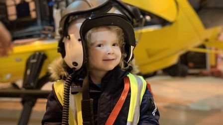 Taverham toddler Harry Deeba at the £3,000 cheque donation to the East Anglian Air Ambulance. Pictur