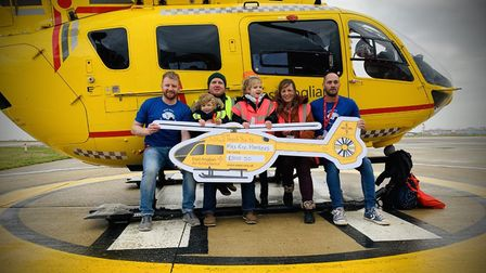Taverham toddler Harry Deeba at the £3,000 cheque donation to the East Anglian Air Ambulance alongsi