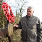 John Marx, from the USA, at the cross to commemorate the B24 Liberator crash at Hardwick airfield 75